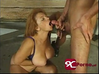 Horny redhead granny with big tits