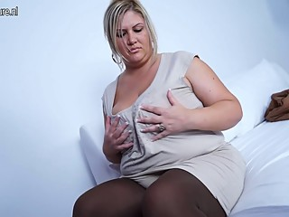 Big breasted mature mom working..